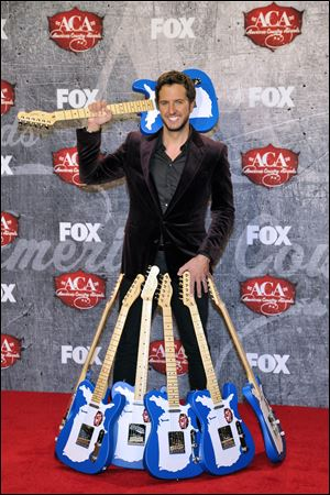Singer Luke Bryan won everything he was nominated for, including artist and album of the year. His smash hit