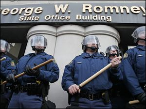 Michigan State Police surround the George W. Romney State Office Building. The office of Michigan Governor Rick Snyder is in the building.