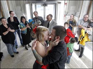 Brandy and Matt Gresock, Toledo, embrace after being married by Reverend John Oliver at the Lucas County Courthouse, Wednesday, December 12, 2012.