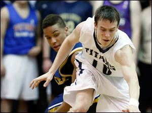 St. John's Austin Gardner (10) steals the ball from Whitmer's Me'Gail Frisch.