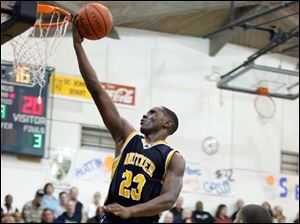 Whitmer's Nigel Hayes skies for the uncontested shot.