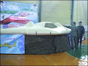 A photo released by the Iranian Revolutionary Guards, claims to show US RQ-170 Sentinel drone which Tehran says its forces downed late last year.