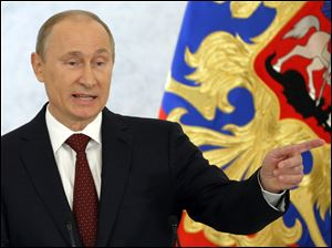 Russian President Vladimir Putin speaks during a state-of-the nation address in Moscow, Russia, today.