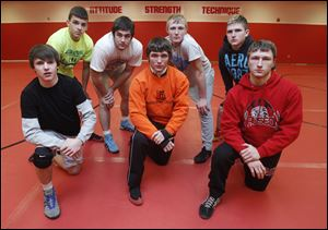 Wauseon will look to win a Northwest Ohio Athletic League wrestling title with (front, from left) Zach Morrow, Austin Yarnell, and Jacob Whitcomb, and (back) Wade Hodges, Zane Krall, Aaron Schuette, and Alec Vonier.