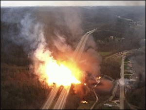 This image provided by the West Virginia State Police shows a fireball erupting across Interstate 77 from a gas line explosion in Sissonville, W. Va., Tuesday.