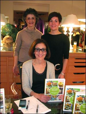 Olivia Summons, left, Meredith Sherman of Sophia Lustig Shop, right. Seated is Olivia's sister Cynthia Kallile of Chicago who was autog