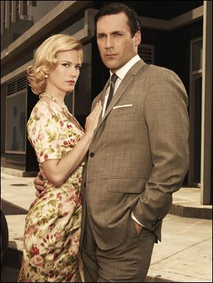 January Jones as Betty Draper, left, and Jon Hamm as Don Draper in
