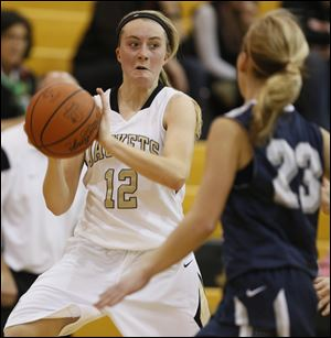 Perrysburg's Maddy Williams (12) steals the ball against Napoleon.