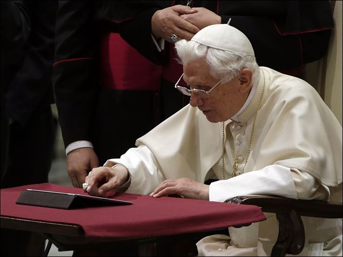 Vatican Pope Tweets  Pope Benedict XVI pushes a button on a tablet at the Vatican today.