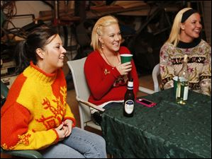Left to right Serena Navarro, Amber Savage, and Michell Niner during an Ugly Sweater party in Delta, Ohio.
