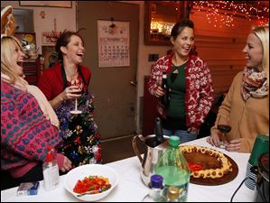 Left to right Shannon Heinemann, Heather Maurer, Amy Husted, and Kelly Kane during an Ugly Sweater party.