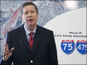 Ohio Gov. John Kasich discusses plans for the Ohio Turnpike, and future funding of Ohio highway projects, during a news conference at Modern Builders Supply in Toledo.