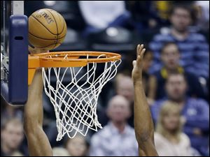 Cleveland Cavaliers' Samardo Samuels puts up a shot against Indiana Pacers' Sam Young on Wednesday in Indianapolis.