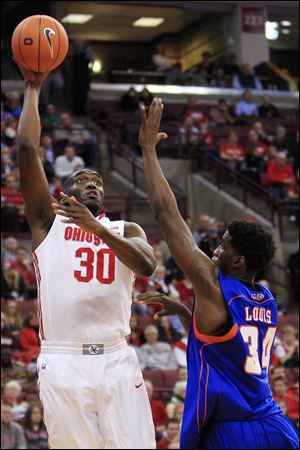 Ohio State's Evan Ravenel shoots over Savannah State's Arnold Louis.