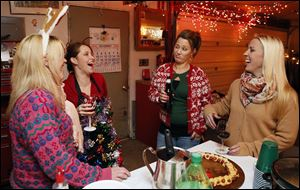 Left to right Shannon Heinemann, Heather Maurer, Amy Husted, and Kelly Kane during an Ugly Sweater party at Maurer's home in Delta.