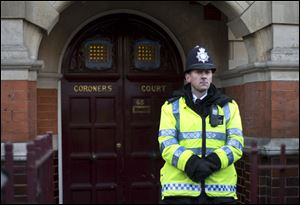 A policeman stands on duty outside Westminster Coroner's Court where the initial inquest into nurse Jacintha Saldanha's death is being opened, in London,Thursday.