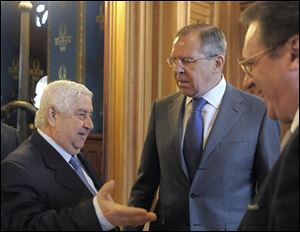 From left: Syrian Foreign Minister Walid Muallem, Russian Foreign Minister Sergey Lavrov and Russian Deputy Foreign Minister Mikhail Bogdanov meet in Moscow. Russia's deputy foreign minister Mikhail Bogdanov said Thursday.