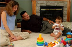 Jennifer Makhlouf and her husband, Joe, watch their son Anthony in their Lambertville, Mich. home. The Makhloufs used preimplantation genetic diagnosis to make sure they made a healthy embryo.