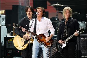 Paul McCartney, center, at the 12-12-12 The Concert for Sandy Relief at Madison Square Garden in New York on Wednesday. Proceeds from the show will be distributed through the Robin Hood Foundation. (AP Photo/Starpix, Dave Allocca)