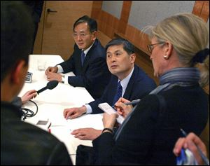 South Korean scientists Woo Suk Hwang, right, and Shin Yong Moon, director of the Korean Stem Cell Research Center, take questions in Seattle after announcing in February that they had cloned human embryos and derived a stem cell line from one of them.