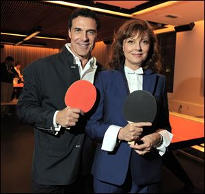 Hotelier André Balazs, left, and actress Susan Sarandon at the opening of SPiN ping pong club at The Standard Hotel in Los Angeles.