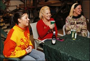 Left to right Serena Navarro, Amber Savage, and Michell Niner during an Ugly Sweater party in Delta.