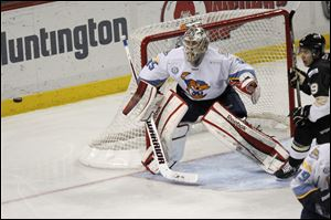 Walleye goalie Kent Simpson keeps his eye on the puck during the third period of Wednesday's game against Wheeling. He finished with 30 saves.