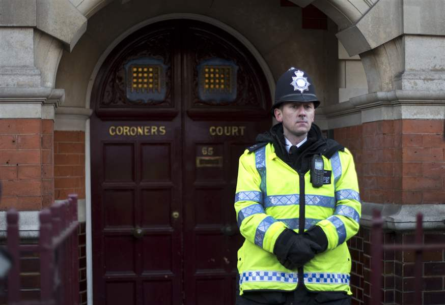 A-policeman-stands-on-duty-outside-Westminster-Coroner-s-Court