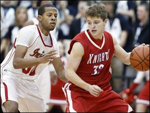 Central Catholic's Deontae Cole (30) defends against St. Francis' Josh Truscinski (32).