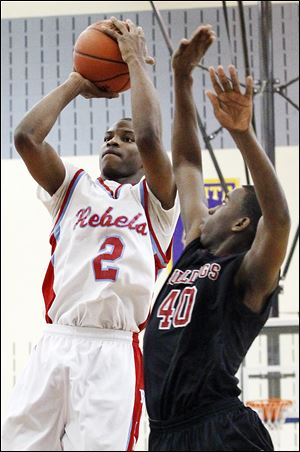 Scott's Chris Harris, who had 34 points, tries to steal the ball from Bowsher's junior Jason Sandridge.