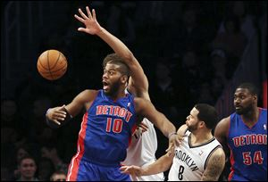 Detroit Pistons center Greg Monroe (10) loses the ball after a drive against Brooklyn Nets guard Deron Williams (8).