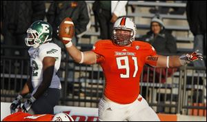 Bowling Green State University player Chris Jones, 91, celebrates after scoring a touchdown after recovering a fumble during the third quarter against Eastern Michigan University at Doyt Perry Stadium in Bowling Green on October 27, 2012.