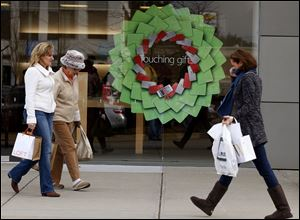 Holiday shoppers haven't found the same heavy discounts as in years past, but prices may fall as retailers seek sales.