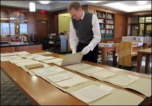 Marquette University Archivist Bill Fliss arranges some of the 11,000 J.R.R. Tolkien papers the university owns in the library of the Milwaukee school - home to the largest Tolkien collection in the world.