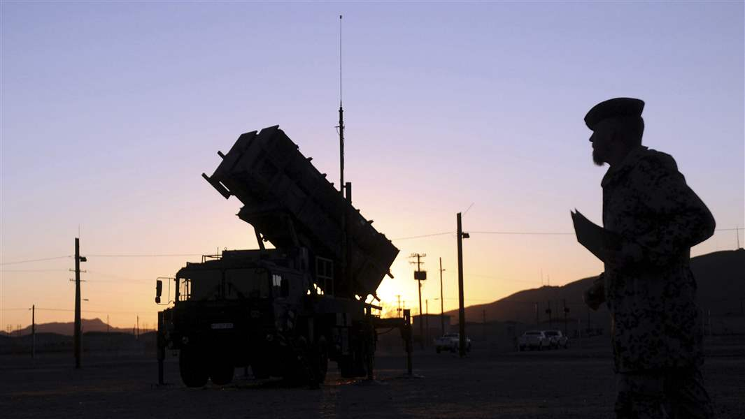 A-German-soldier-stands-next-a-Patriot-surface-to-air-missile