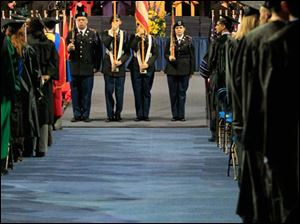 Members of the UT Army ROTC Pershing Rifle Color Guard at the beginning of the event.