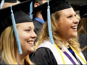 Heather Reau, left, from Oak Harbor who is graduating Cum Laude in the Bachelor of Science in Education, and Molly Bacni, right, who is graduating with University Honors, react to a speaker.