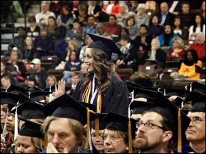 Katrin McBroom stands and waves while being recognized for graduating with University Honors.