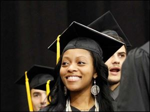 Micah Harris, from Detroit, processes in line before receiving her Bachelor of Science.