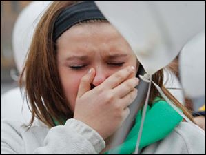 Ali Kujawa, 16, of Perrysburg, cries during a performance of,