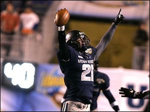 Utah State's Brian Suite celebrates after a fumble recovery against Toledo.