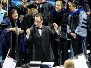 Jason Stumbo conducts members of the University of Toledo Wind Ensemble as they perform Edward Elgar's