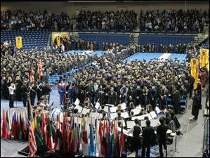 Graduating students of the University of Toledo enter the arena for the commencement exercises.