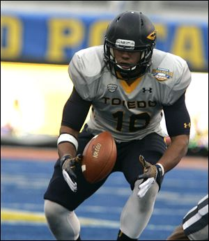 Toledo's Chuck Jacobs misses a pass against Utah State.