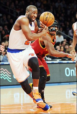 New York Knicks guard Raymond Felton, left, loses the ball as Cleveland point guard Kyrie Irving defends Saturday at Madison Square Garden in New York.