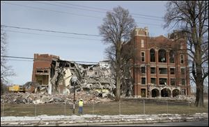 Libbey High School, in South Toledo, fell in early 2011. The site is one of about two dozen that are vacant in the Toledo district.