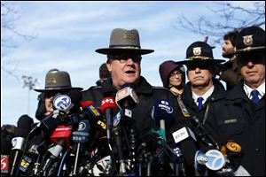 Lt. J. Paul Vance of the Connecticut State Police conducts a news briefing, Saturday.