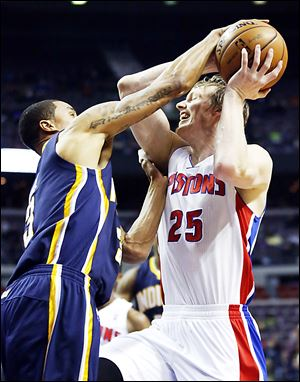 Detroit Pistons forward Kyle Singler, right, has a shot blocked by Indiana Pacers guard George Hill, whose 15 points helped sink Detroit.