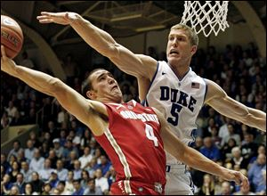 Ohio State's Aaron Craft puts up a shot against Duke's Mason Plumlee last month in Durham, N.C. The loss to the Blue Devils has been the only blemish so far for the Buckeyes.