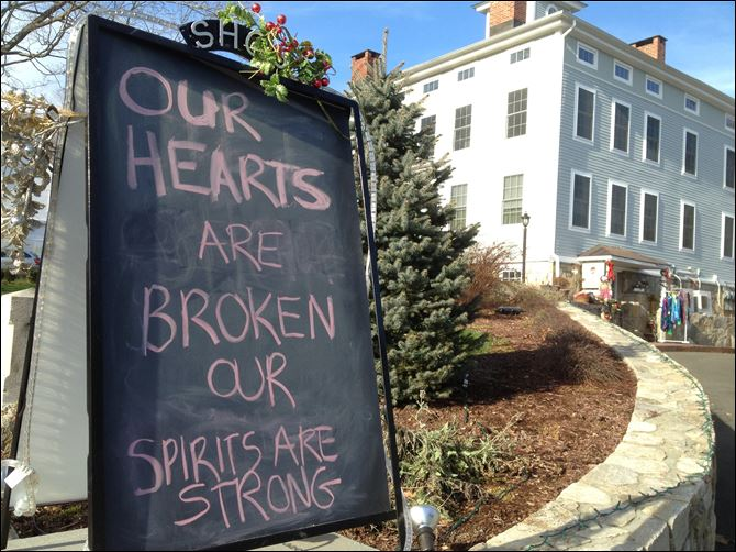 A condolence sign sits in downtown Sandy Hook A condolence sign sits in downtown Sandy Hook, Conn., on Saturday.
